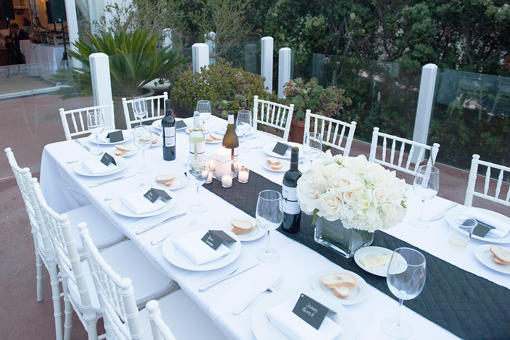 photo of place settings on long formal outdoor dinner table on deck of Revolve Malibu Beach House produced by lob•group