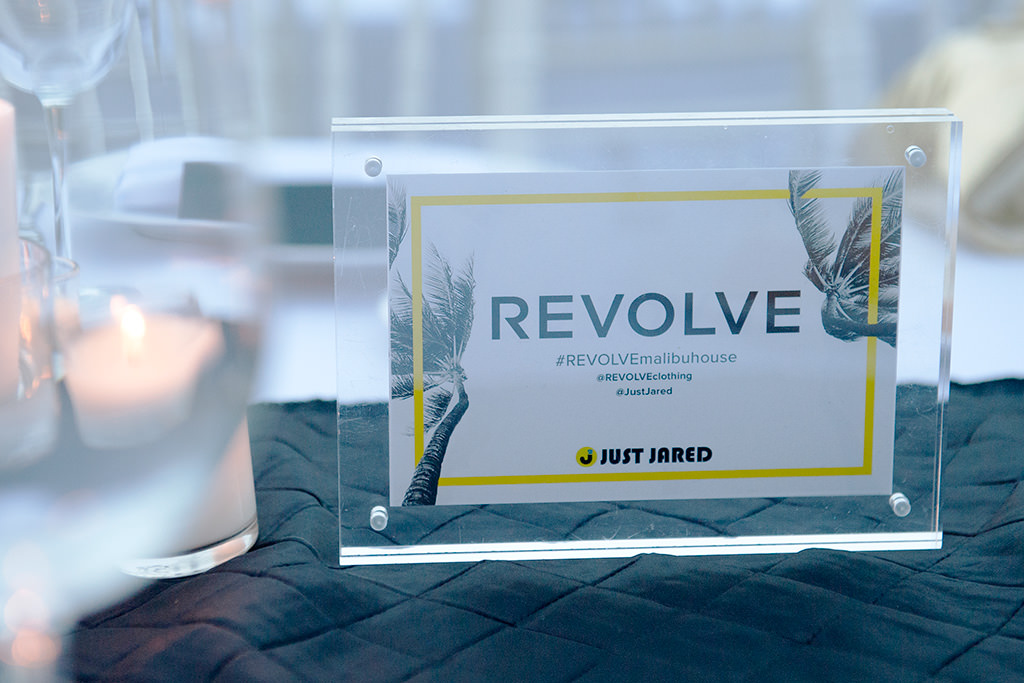 photo of Revolve Malibu Beach House placard with candles