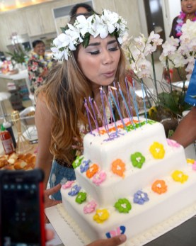 photo of Jessica Sanchez blowing out birthday cake candles