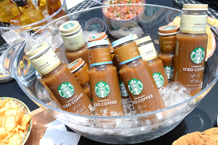 photo of bottles of Starbucks Iced Coffee on ice at Revolve Malibu Beach House event