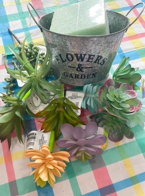 galvanized pail with faux succulents