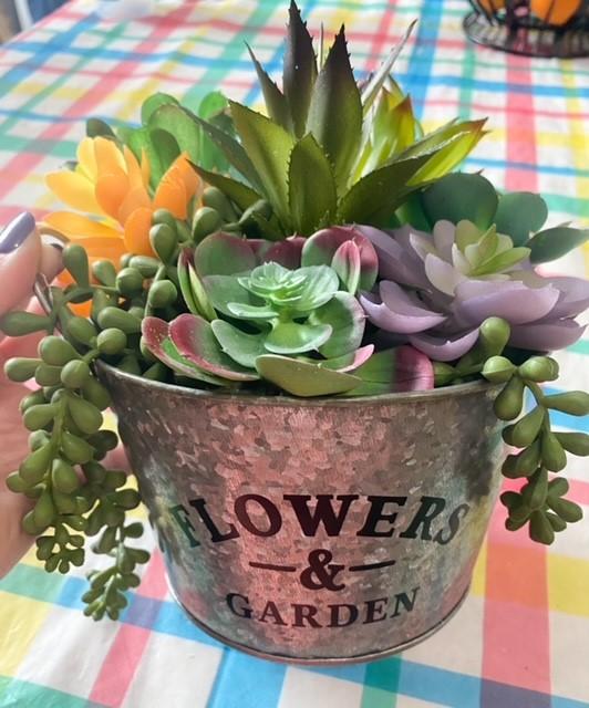 faux succulents in galvanized pail