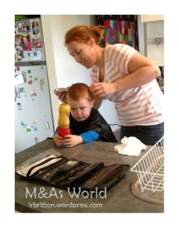 Hair cut time- See him eyeing the chocolate bunny as bribery for sitting still!!