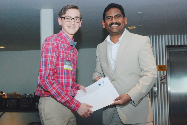 Student receives certificate from sponsor