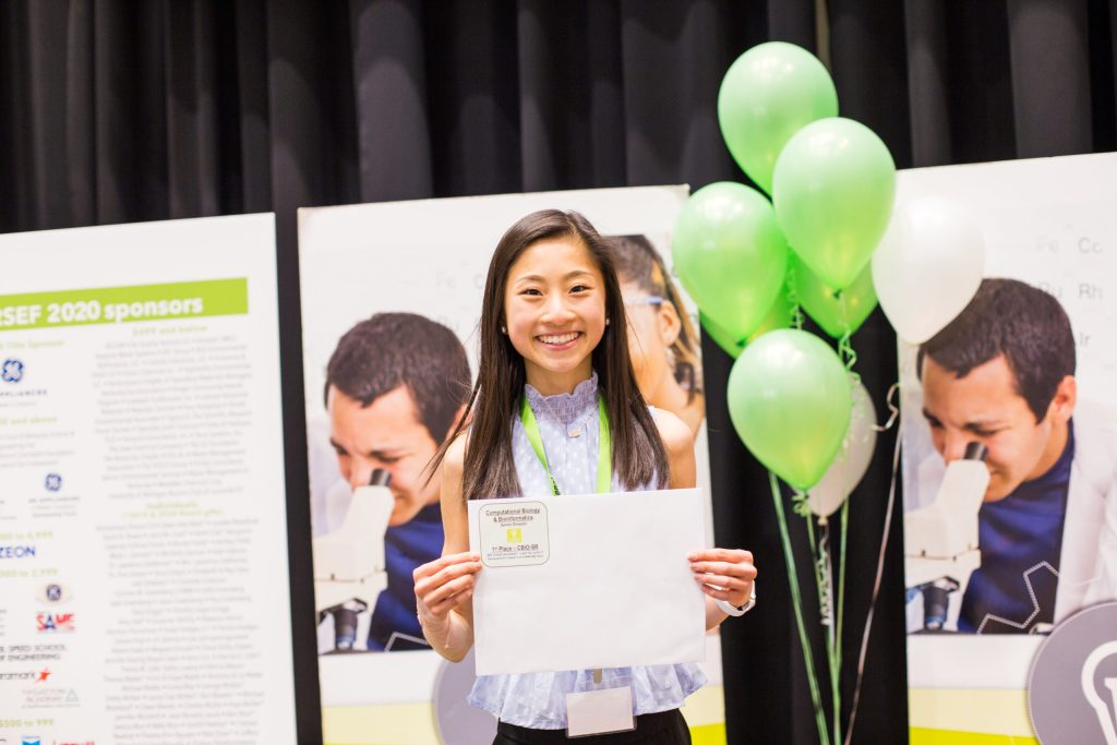 LRSEF participant Gloria Huang poses with her LRSEF award certificate.