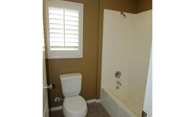 Shower/tub and toilet for Jack-and-Jill Bathroom.