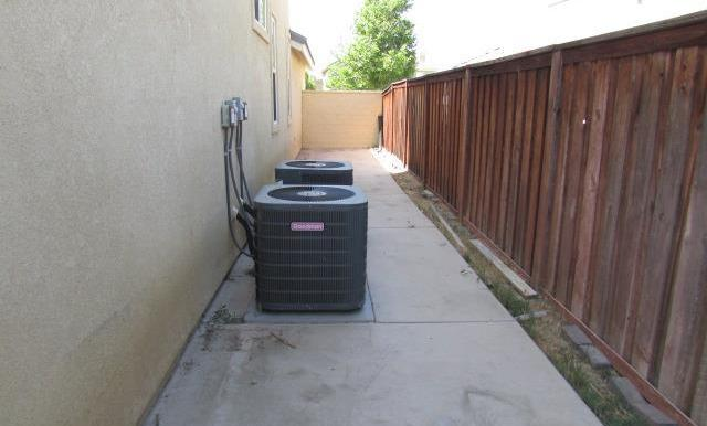 Dual A/C systems are on the side yard.