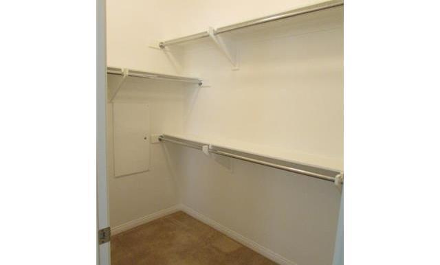 Master bedroom walk in closet (goes both directions.)