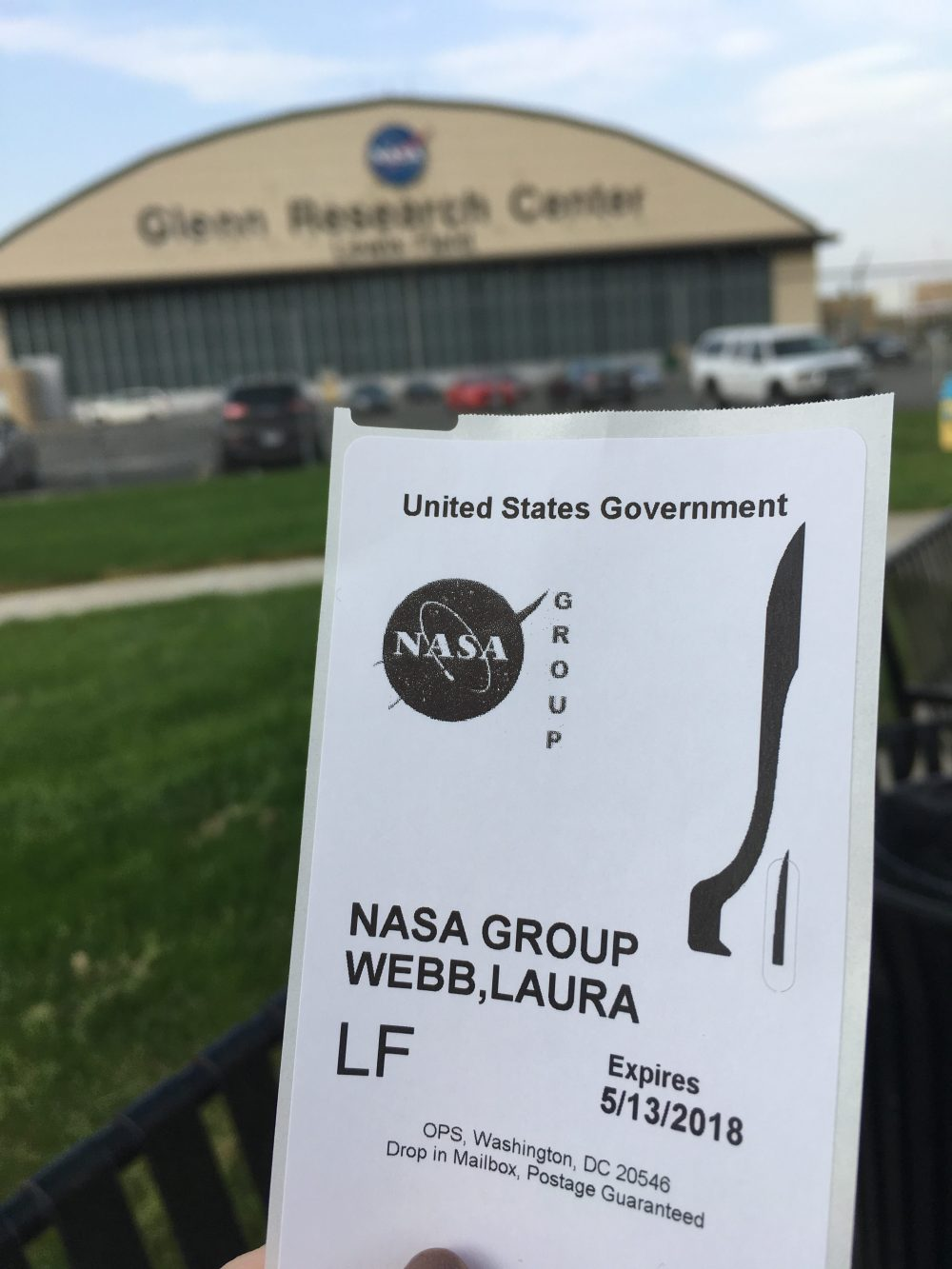 Admission ticket to the NASA Glenn Research Center, with one of the NASA Glenn buildings in the background