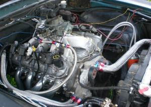 Anyone tried a carb intake and dist on a ls1?  LS1TECH