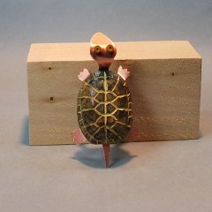 Turtle wood carving by Lora Irish.