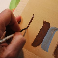 How to paint detail lines on your relief carvings, free project by Lora Irish