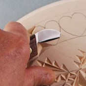 cutting a curve-wall chip in chip carving