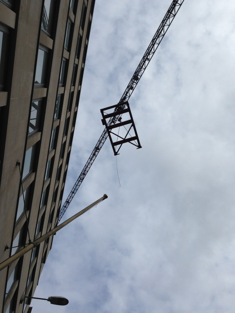 view of crane in Fleet St, London, from ground level