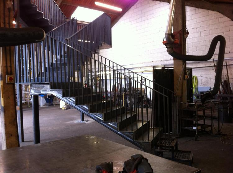 a steel staircase in a construction area