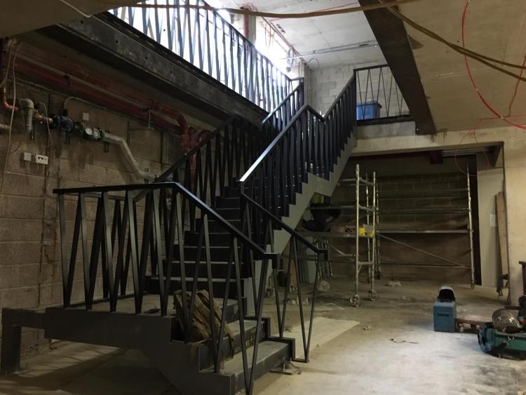 black steel staircase downstairs