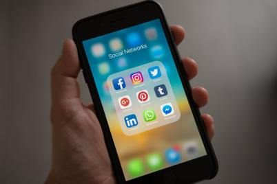 Image of a phone with social media apps representing the number of platforms out there where you can get support for the mental health aspects of Lichen Sclerosus.