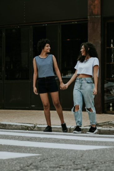 Image of a couple in a relationship holding hands, which can be a great way to connect and maintain physical intimacy when in an LS flare.