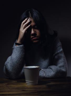 Image of person looking sad and alone at their desk representing how alone Jaclyn felt in her diagnosis.