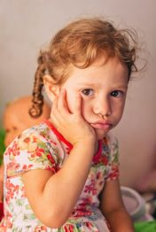 Image of a small child looking sad and upset. This is probably how Heather felt as a small child being dismissed by the medical system and her family.