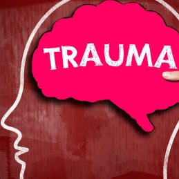 Image of a silhouette of a human head with the word 'Trauma' in caps in the brain region, representing my history with sexual assault and how grateful I was to have a physiotherapist who was trauma informed.