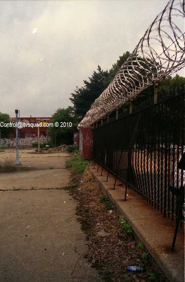 North side fencing, resembling that of a prison.