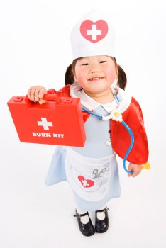 Child showing first aid kit
