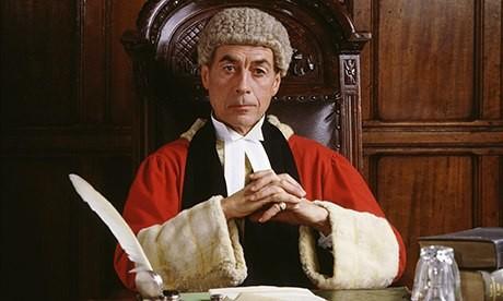 Judge with hands interlinked