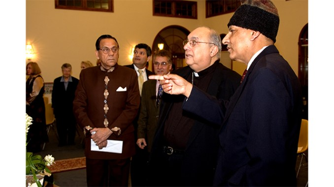 In photo, Zia Rahman, right, points out features of the Muslim mosque in Voorhees to Most Rev. Bishop Joseph Galante, of the Roman Catholic Diocese of Camden.