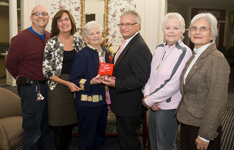 Manchester Township, New Jersey, USA - Thursday November 3, 2011: Members of the production team assembled with the 2011 JASPER Award presented to PROFIT Communications and Lubetkin Global Communications for the 10-minute documentary video about The Pines at Whiting Continuing Care Retirement Community. The firms received the award from the Jersey Shore Public Relations and Advertising Association. From left: Steve Lubetkin of Lubetkin Global Communications; Deborah L. Israel, president and ceo, ProfitCom; Charity Roszel; Bill Janson, president, The Pines at Whiting; Mary Jane Ousley; and Paulette Kaufman, director of sales and marketing, The Pines at Whiting.
