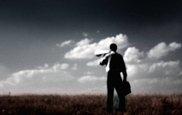 Shouting through a megaphone to an empty landscape