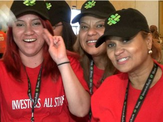 Participants in the Investors Bank retail playbook launch event show their team spirit.