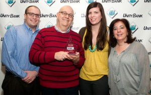 """One of our Silver ASTRA Awards was for documentary video services, in the """"Video Up to 3 Minutes"""" category, for a series of business banking customer videos produced for Unity Bank, Clinton, NJ. Posing with the award at the bank's headquarters are (from left): Dustin Coughlin, Marketing Coordinator, Unity Bank; LMC managing partner Steve Lubetkin; Crystal Stoneback Rose, Assistant Vice President, Marketing, Unity Bank, and Rosemary Fellner, Vice President, Marketing, Unity Bank."""