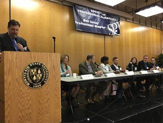 Ken HUnter, APR, at lectern, moderates 2017 PRSA-NJ Meet the Media panel, at Montclair State University, March 30.