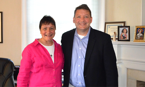 Sister Debbie Dragos, executive director of Collier Youth Services, with Greg Scharpf of Amboy Bank.