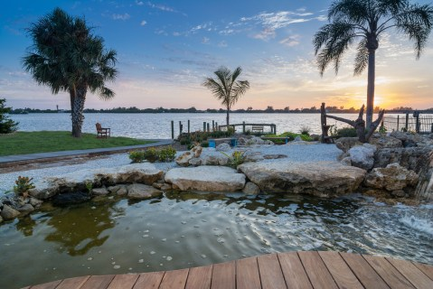 Bay view of Natural Florida Limestone Pond and Custom Pool in Osprey, Florida