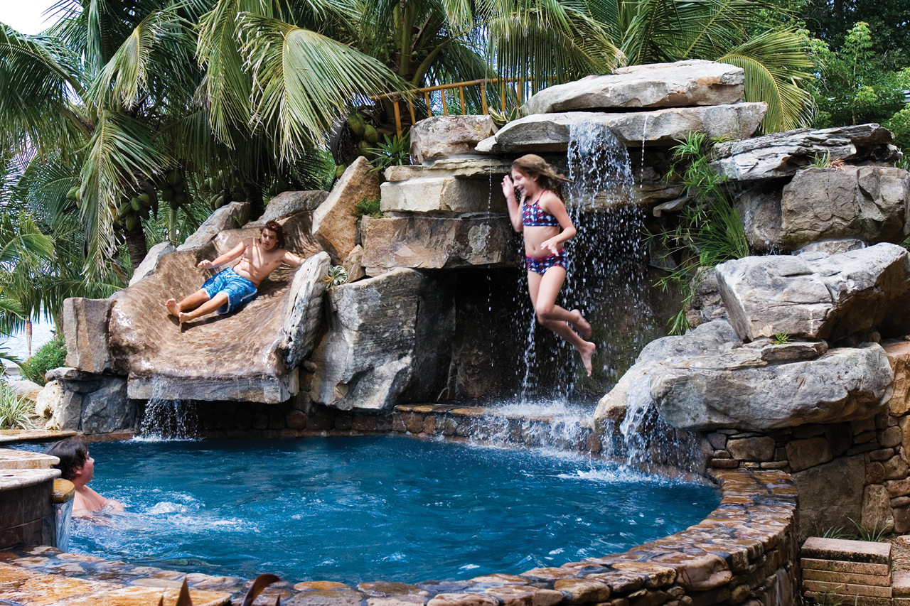 custom swimming pool with natural stone waterfalls and pool grotto kids - Swimming Pools With Grottos