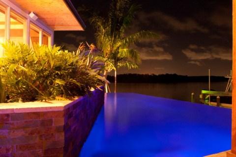 Infinity edge pool with modern planter