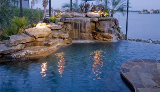 Grotto and infinity edge pool with flagstone deck