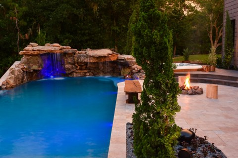 Natural rock lagoon pool and waterfall with large outdoor living space
