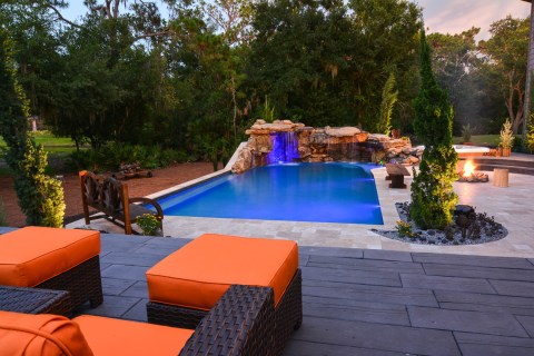 Overview from the top tier of the outdoor living space and natural stone lagoon pool complete with outdoor furnishings