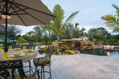 Natural Lagoon Pool with Bar and Outdoor Kitchen