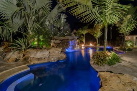 Natural Lagoon pools Swim up bar and seating with natural stone grotto