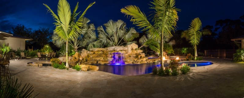 Night Panorama view of natural Lagoon Pool with rock waterfalls, pool waterfalls