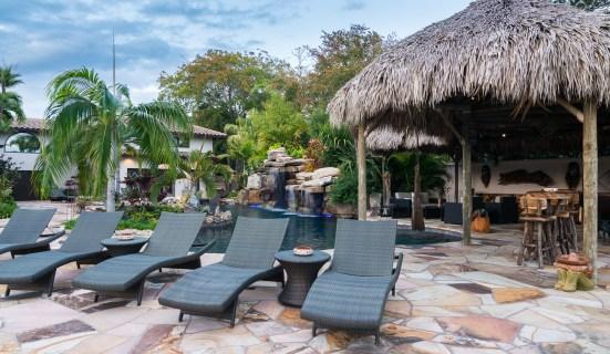 natural-rock-waterfall-pool-siesta-key-loung-chairs-tiki-hut