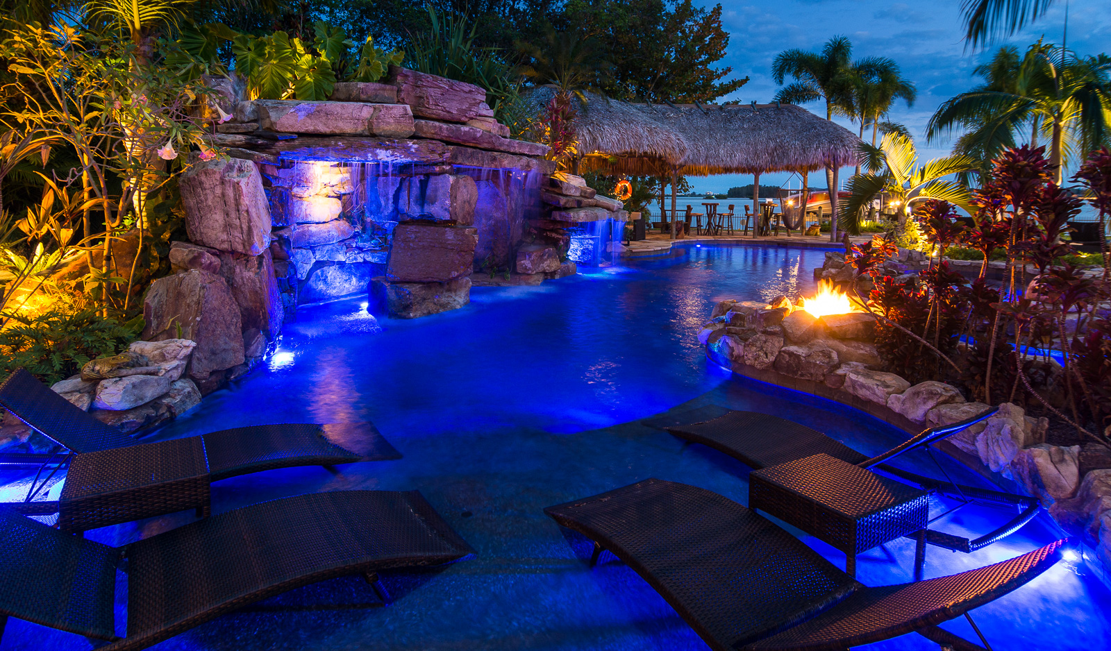 Design Waterfall Pools custom rock waterfall pool grotto spa natural stream tiki hut siesta key pools sun