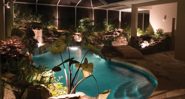 lucas lagoons pool remodel with wooden bridge night view entrance