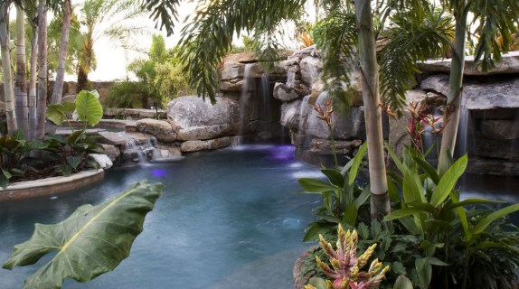 Tropical landscaping surrounding natural lagoon pool