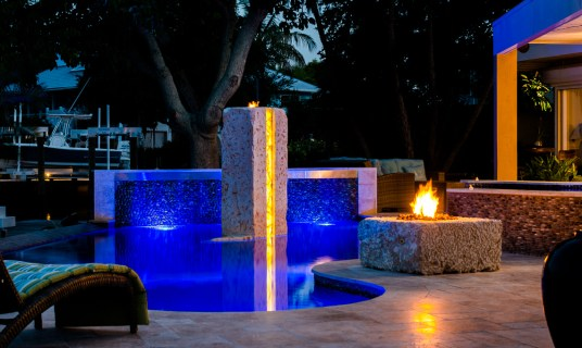 The warm glow of the Fire contrasts the deep blue of the Modern Pool