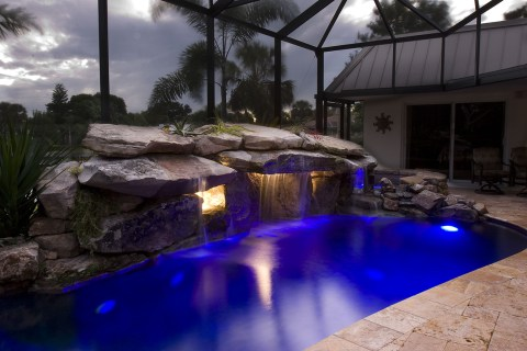 Pool Remodel with Stone Grotto Waterfall and Stone Spa underwater lighting